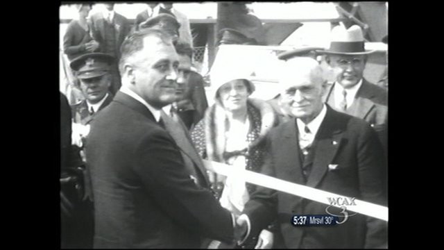 Gov. Franklin D. Roosevelt and Gov. John Weeks shake hands at the bridge opening