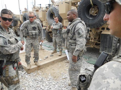 Pre-convoy briefing conducted by Lt. Willie Spears (second from right)