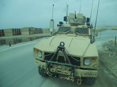 Convoy out the rear window of an MRAP
