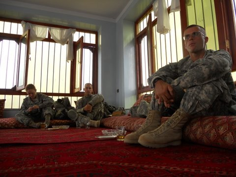 Lt. Sam Morse of Camden, NY listens to local Afghan leaders