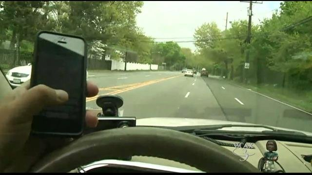Driver using phone hits cop enforcing distracted-driving law