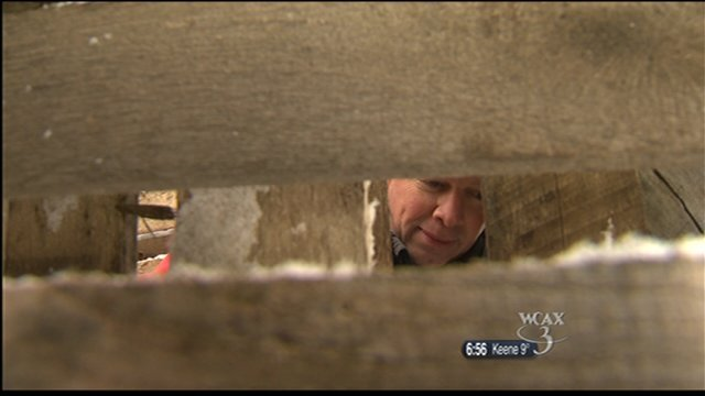 Mike Halpin hides in a pile of pallets, waiting for Abel to find him.
