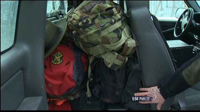 A sample of the gear inside a game warden's truck, including a search and rescue bag and a tagging kit.