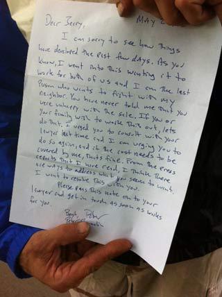 Dodge shows the letter he got from Gov. Peter Shumlin.