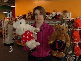 Reporter Bianca Slota holds the boxer-wearing Heart Throb Bear and the boxer brief-wearing Huggable Hunk bear.